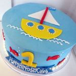 Round ocean and sailing theme birthday cake for one-year-old